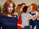 Christina Hendricks is elegant in demure navy dress but almost ruins group selfie with her famous pals by looking the wrong way