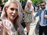 Doting duo: Kesha held hands with her boyfriend Brad Ashenfelter as they stepped out in New York City on Thursday