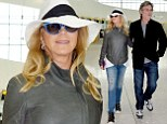 Goldie Hawn and Kurt Russell in Heatrow airport