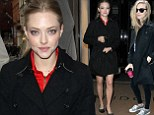 It goes with everything: Amanda Seyfried proves her black trench coat looks good with smart flats and Converse trainers while out and about in London