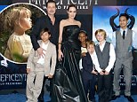Say cheese! Brad Pitt and Angelina Jolie are joined by their children on the Maleficent red carpet for adorable family picture... but Vivienne misses her big screen debut