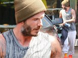 Hot and sweaty David Beckham flexes his tattooed biceps after an intense workout at SoulCycle