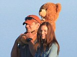 We thought it was an action movie! Sienna Miller and Bradley Cooper looked loved up in character on the set of American Sniper
