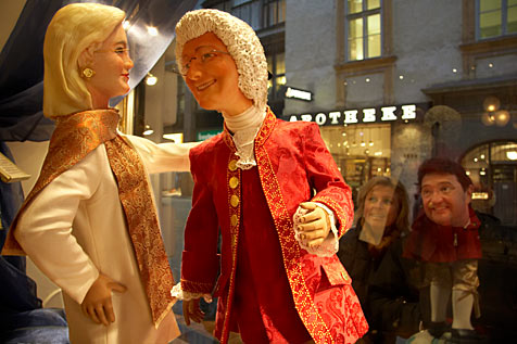 """A marzipan replica of Austrian Federal Chancellor Wolfgang Schüssel is dancing with Foreign Minister Ursula Plassnik in the shop window of the """"Imperial and Royal Court Confectionary Bakery"""" Demel in Vienna. Schüssel is dressed up like Mozart with a white wig made out of sugar and in a red brocade robe. Wolfgang Schüssel is standing on a globe out of sugar icing which should illustrate Europe"""