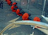 Military Police guard Taliban and al-Qaeda detainees at the infamous Camp X-Ray in the Guantanamo Bay prison complex; suspected terrorists get meals, medical care and entertainment at U.S. taxpayer expense, but they can be held indefinitely