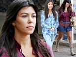 Kourtney Kardashian hides any signs of a baby bump in TWO baggy outfits... while keeping mum on pregnancy rumours