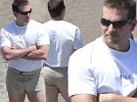Action star! Bradley Cooper gets hosed down in eye-wateringly tight short shorts on set of American Sniper