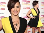 Demi Lovato steals the spotlight in a statement black and yellow frock as she picks up Fun Fearless Latina Of The Year Award