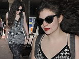 Mixing it up in monochrome! Lorde adds some white into her trademark grungy black look as she touches down in London