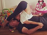Her best cushioned mat yet! Hilaria Baldwin leans on tubby husband Alec in relaxing yoga pose of the day