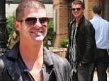 Now that's a close shave! Robin Thicke sports a super-short buzz cut as he leaves his hotel in NY
