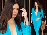 She's electric! Kendall Jenner wows in plunging bright blue pantsuit for a signing of new sci-fi book with Kylie