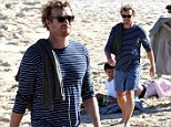 Still a Bondi babe at 44: Handsome Simon Baker returns from Hollywood for family fun at the beach