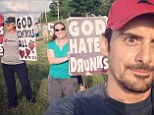 Baptism of ire! Brad Paisley winds up church activists by taking cheeky selfie at rally protesting his show in Kansas