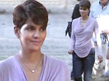 Ready for blast off! Halle Berry is in high spirits as she prepares to shoot scenes as pregnant astronaut for TV show Extant