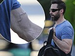 Jacked Man: Hugh Jackman looked ripped as he headed to the gym in New York on Tuesday