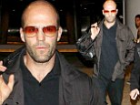 Flying solo: Jason Statham, 46, appears down in the dumps as he exits airport without his younger girlfriend Rosie Huntington-Whiteley, 27