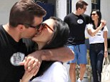 Packing on the PDA: Actress Olivia Munn, 33, scores a kiss from her new boyfriend and Green Bay Packers quarterback Aaron Rodgers, 30, as they enjoy an intimate lunch in LA on Friday