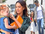 Double the fun! Jessica Alba and husband Cash treat both their girls to new bikes and toys for Honor's birthday