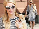 Showing her stripes! Paris Hilton displays her slender curves in black and white dress while out with her pup Peter Pan