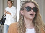 Fraternal fashions: Ashley Olsen, left, appeared effortlessly chic, as Mary-Kate Olsen, right, missed the mark during a shopping trop to L'Agence in West Hollywood, California on Friday