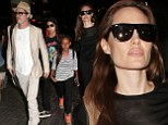 My family of jetsetters! Angelina Jolie and Brad Pitt catch a flight out of town with their children Maddox and Zahara