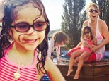 'Pose like Mommy!' Mariah Carey's daughter Monroe is a little diva in the making during family day at the hot tub