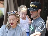 One happy family? Hilary Duff and Mike Comrie look in sync during lunch with son in Beverly Hills... after her sister says 'they're great'
