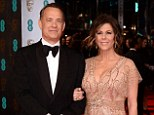 25 years and still smiling: Tom Hanks has been happily married to his second wife Rita Wilson for a quarter of a decade