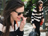 Busy single mother Liv Tyler dashes out of her Manhattan apartment with wet hair and no make-up