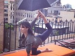 Raindrops won't fall on her head! Hilaria Baldwin performed her yoga pose of the day while holding an umbrella in an Instagram snap posted Friday