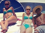 No more working for a week or two! Iggy Azalea shows off famous curves in skimpy green bikini as she lounges with ripped beau Nick Young on a luxury yacht