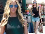 Rosie Huntington-Whiteley puts on a long and leggy show in tiny cut-off shorts as she stocks up on veggies at the market