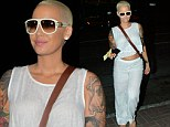 Amber Rose flashes her toned midriff in crop top as she leaves husband and son at home for dinner out