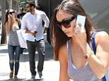 Jesse Metcalfe takes girlfriend Cara Santana shopping in first sighting since Courtney Robertson labels him 'pretty average' in bed