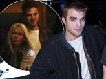 He loves the nightlife! Actor Robert Pattinson steps out with a crowd of pals during Australian visit