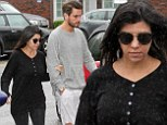 Kourtney Kardashian covers up 'baby bump' in baggy black sweater as she and Scott Disick grab lunch in The Hamptons