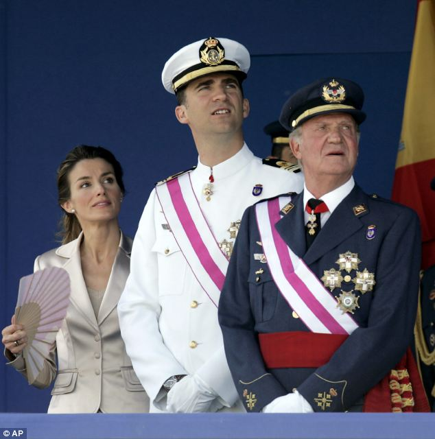 King Juan Carlos (far right) will hand the crown to his son, Prince Felipe (centre), pictured with Princess Letizia watching an air display in 2006