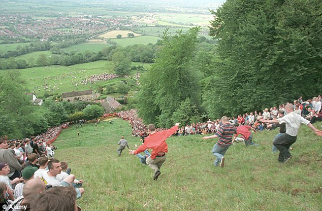 Cheese rolling: Up to 5,000 people every year tumble down Cooper's Hill chasing a 9lb Gloucester cheese