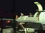 Sgt. Bowe Bergdahl landed on American soil in the early hours of Friday morning after more than five years in captivity spent with the Taliban. Pictured are people as they are greeted on arrival at Lackland Air Force Base, in San Antonio, Texas, early Friday morning