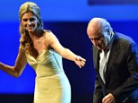 On stage: Brazilian presenter Fernanda Lima with Sepp Blatter (right) at the FIFA Congress
