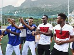 SAMBA! England players Danny Welbeck and Daniel Sturridge with Brazilian dancers in Rio