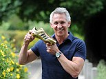 Glory days: Former England striker Gary Lineker proudly shows off his Golden Boot from the 1986 World Cup