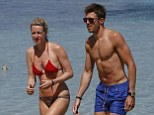 Relaxing: Michael Carrick in Ibiza with his wife Lisa but the midfielder could be called back