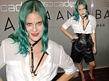 Taking after her sister! Tallulah Wills goes braless in leather harness and corset at fashion event