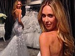 Model Nikki Phillips showcases her svelte silhouette in behind-the-scenes shot of her custom-made wedding gown