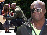 Sweet: Seal was seen giving his daughter Lou a hug as he visited his children's school for graduation day in Los Angeles on Wednesday