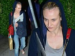 Different looks: Diane Kruger opted to go make-up free and don casual clothes, as her boyfriend Joshua Jackson, right, dressed to impress to celebrate his birthday at Giorgio Baldi restaurant in Santa Monica on Wednesday