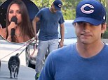 Incognito Ashton Kutcher walks rescue dogs following his fiancée Mila Kunis' speech against the term 'We're pregnant'