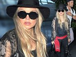Fergie dresses in a pirate-inspired ensemble as she lands in LAX with husband Josh Duhamel